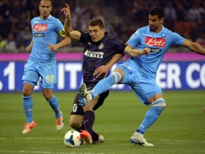 Inter Milan's Croatian midfielder Mateo Kovacic (L) fights for the ball with Napoli's Uruguayan defender Angel Miguel Britos during the Italian Seria A football match Inter Milan vs Naples, on April 26, 2014 at the San Siro stadium in Milan. AFP PHOTO / OLIVIER MORIN (Photo credit should read OLIVIER MORIN/AFP/Getty Images)
