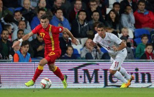 Wales' Gareth Bale (left) and Serbia's Aleksandar Kolarov battle for the ball